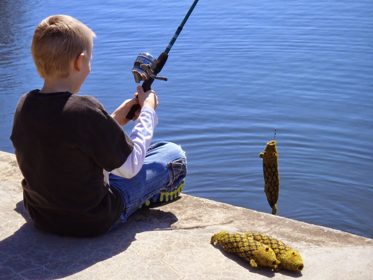 Charlie the fish with a boy fishing